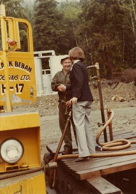 Iona Campagnolo shaking hands with unidentified employee of Frank Beban Logging