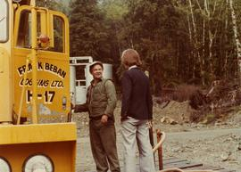 Iona Campagnolo standing with unidentified employee of Frank Beban Logging