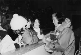 Iona Campagnolo talks with three unidentified teenage girls in the Cassiar arena