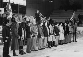 Jan Kapicky from Cassiar with a group of people lined up in front of a stage in an arena with man...