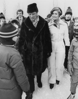 Iona Campagnolo and Pierre Trudeau at a children's speed skating event during the Northern B...