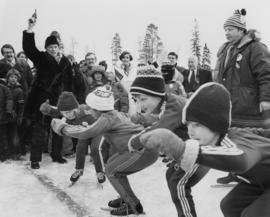 Pierre Trudeau fires a starting pistol at a children's speed skating event during the 1978 N...