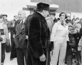 Iona Campagnolo, Pierre Trudeau and Ron Basford talk with a crowd at a children's speed skat...
