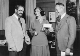Iona Campagnolo and Cyril Shelford accept a cheque from the Minister of Finance