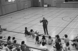 Gym teacher speaks to physical education students at Mount Elizabeth Secondary School