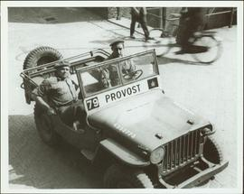 Two members of the No. 1 Canadian Provost Corps in a jeep
