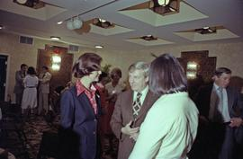 Iona Campagnolo and Premier Peter Lougheed talk with people at the Crest Hotel in Prince Rupert
