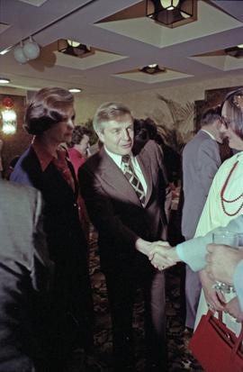 Iona Campagnolo and Premier Peter Lougheed greet unidentified people at the Crest Hotel in Prince...