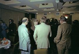 Iona Campagnolo and Premier Peter Lougheed talk with three unidentified men at the Crest Hotel in...