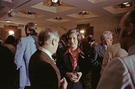 Iona Campagnolo talks with Premier Peter Lougheed and unidentified men at the Crest Hotel in Prin...