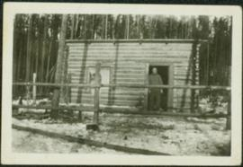 Unidentified Man at Log Building