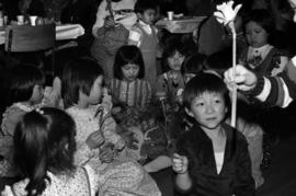 Chinese-Canadian Children hold flowers at a Chinese New Year event in Prince Rupert