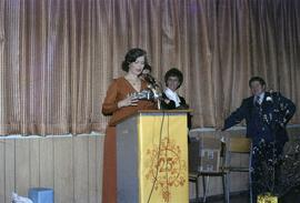 Iona Campagnolo speaks at podium during 25th Birthday event for the city of Kitimat