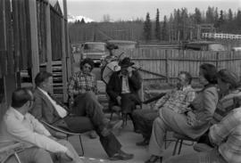 Minister Jack Horner, Bill Campbell, Iona Campagnolo and others meeting outside in Smithers