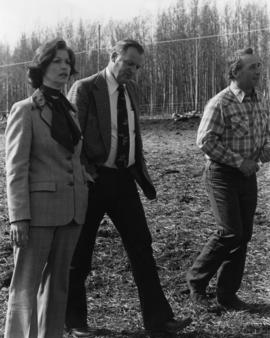 Iona Campagnolo stops in a cow pasture with Minister Jack Horner and unidentified man