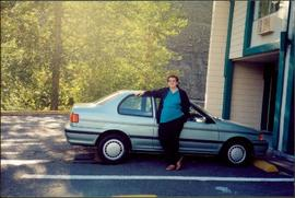 Bridget Moran Standing Beside Car