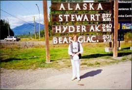 Unidentified Woman at Alaska Signage