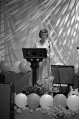 Woman speaking at Queen Charlotte Secondary School graduation ceremony