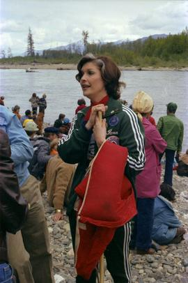 "Iona Campagnolo stands on river bank during ""Delta King Days"" raft race event"