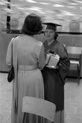 Iona Campagnolo shaking hands with a graduate at Queen Charlotte Secondary School graduation cere...