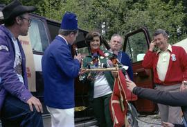 Past exhaulted ruler of Kitimat Elks presents Iona Campagnolo with handmade rafting figurines at ...