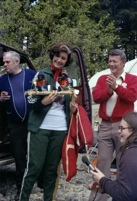 Iona Campagnolo holds handmade rafting figurines at Kitimat Delta King Days raft event with Mayor...