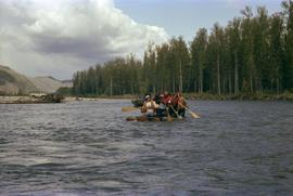 Iona Campagnolo and four unidentified men paddling raft on Kitimat River