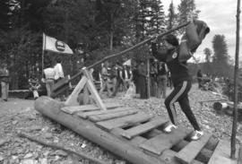 Iona Campagnolo tests rudder on raft at Kitimat Delta King Days raft race event