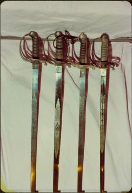Closeup of the blades of four swords of the Royal Irish Constabulary