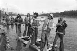 Iona Campagnolo and unidentified men stand on raft during Kitimat Delta King raft race