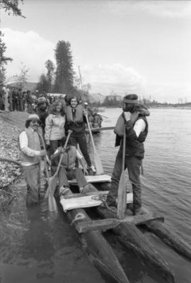 Iona Campagnolo and others stand on raft during Kitimat Delta King raft race