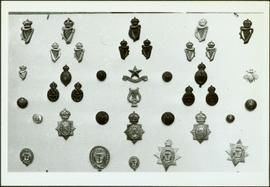 Closeup of badges of the Royal Irish Constabulary, Belfast Harbour Police and the Royal Irish Rangers [?]