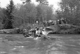 Iona Campagnolo paddles raft with unidentified men during Kitimat Delta King Days raft race