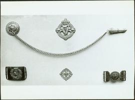 Closeup of Royal Irish Constabulary badges, buckles and whistle chain