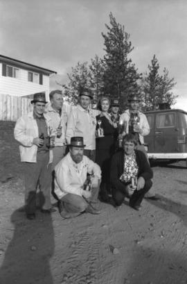 Winning team of the Kitimat Delta King Days raft rce pose for group portrait with Iona Campagnolo