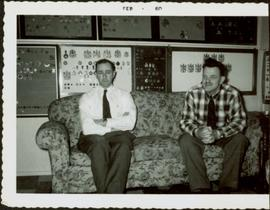 James Joseph Claxton seated on a couch beside an unidentified man