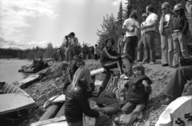 Iona Campagnolo and others sitting on rafts on shore during the Kitimat Delta King Days raft race