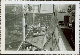 James Joseph Claxton's badge collection in the window of Roderick Jewelers, New Westminster