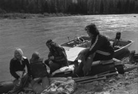 Iona Campagnolo sitting on beached raft with man and children during the Kitimat Delta King Days raft race