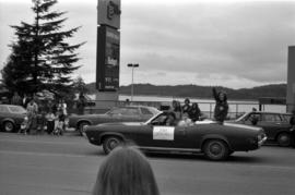 Iona Campagnolo waves from convertable in Prince Rupert Sea Festival Parade