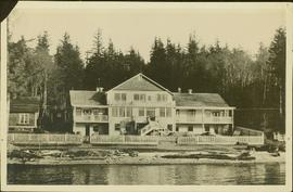 Large, unidentified house situated along a shoreline