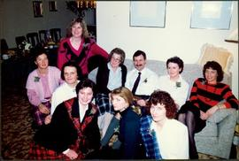Bridget Moran in Group Seated in Living Room