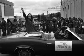 Iona Campagnolo waving from convertible in Prince Rupert Sea Festival Parade