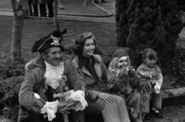 Iona Campagnolo, man in pirate costume, and children sitting on the curb at the Prince Rupert Sea...