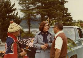 Iona Campagnolo with Gitxsan chief Ken Harris and a man wearing a button blanket at the Prince Ru...