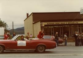 Iona Campagnolo pointing to crowd while atop convertible in Prince Rupert Sea Festival parade