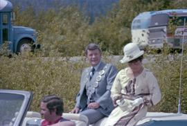 Mayor George Thom and woman riding on convertible in the Kitimat Captain Cook Bicentenary parade