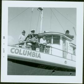 Ship Captain and five First Nations children on the deck of the M.S. Columbia