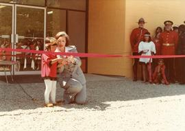 Iona Campagnolo with child cutting ribbon at opening of Haisla Recreation Centre in Kitamaat Village