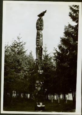 Totem pole standing amongst the trees